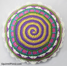 """This 14"""" round pillow is as fun to make as it looks! Every round takes you on an adventure. This one was made with Cascade 220."""